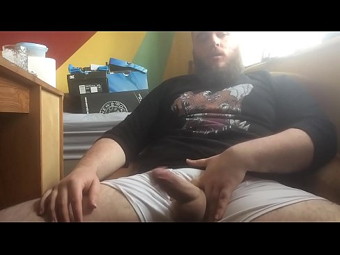 Bearded Guy Strokes His Huge Cock And Balls & Shoots Cum
